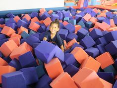 JUMP AND CLIMB AND SWING! LOTS OF FUN AT THE YMCA GYMNASTICS GYM.