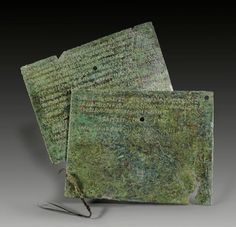 Roman military diploma from the regency of Hadrian, year 119 A.D. The diploma had been emitted for a member of the Praetorian Guard. The diploma is complete and consists of two tabulae which had been tied together by a bronze thread which is patially preserved, 15.5 x 12 cm. Private collection