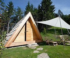 Eco-friendly Slovenian glamping huts in the classic A-Frame style have all the luxury of a teeny hotel room.