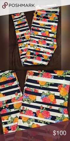 Lularoe RARE leggings These are absolutely BEAUTIFUL!! I bought them and tried them on.. but I'm too afraid to wear them and get them dirty lol.. I know I'm silly! But these are OS. New. This is the rare Julia pattern! Navy/Black/White/Floral LuLaRoe Pants Leggings