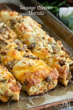Homemade Sausage Cheddar Biscuits, this portable breakfast has the sausage and cheese baked right in. Homemade Sausage Cheddar Biscuits, this portable breakfast has the sausage and cheese baked right in. Biscuits Au Cheddar, Queso Cheddar, Sausage Biscuits, Cheese Biscuits, Flaky Biscuits, Cheddar Cheese, Brunch Recipes, Gourmet Recipes, Cooking Recipes