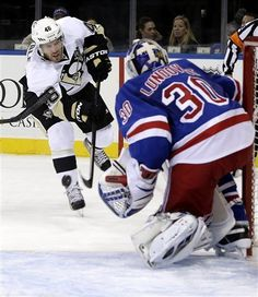 Pittsburgh Penguins' Joe Vitale, left, takes a shot on-goal defended by New York Rangers' Henrik Lundqvist during the first period of the NHL hockey game in New York, Sunday, Jan. 20, 2013. (AP Photo/Seth Wenig)