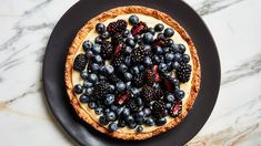 In this simple fruit tart recipe, a delicious almond crust is the perfect complement to the creamy custard and berry filling. You can also make it nut-free.
