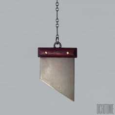 """Carry the weight of history with La Demi-Lune Pendant. Each piece consists of a hand crafted sterling silver blade. Each blade is then topped with genuine purpleheart hardwood and secured in place with brass rivets. The pendant hangs from a 26"""" sterling silver chain with a 3.5"""" drop at bottom.During the span of its usage, the guillotine has gone by many names, some of which include La demi-Lune, or The Half-Moon and is best known for its role during the French Revolution. Th..."""