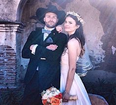Our beautiful #indebride Cassidy, and her dapper cowboy, Jamie. Cassidy fell in love with our handcrafted bubble hem silk dress with chiffon draped bodice and venetian lace trim...breathtaking. Worn with our handcrafted veil.