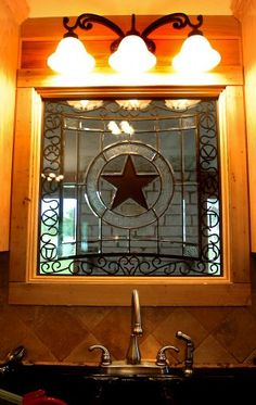 Judy and Bob Crowder live in a red and Texas Lone Star flag themed home with a Texas star inlay window in the kitchen.