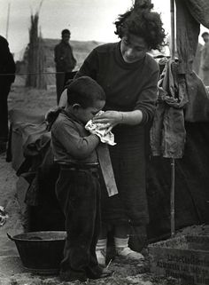 A Spanish woman and her child are amongst the thousands of Spanish Republican soldiers, activists and supporters who fled across the border to France after the Spanish Civil War. Once in France, they were placed in internment camps for Republican exiles. After the German occupation of France and the creation of the collaborationist Vichy government, many were sent to labor and concentration camps.Argelès-sur-Mer, Pyrénées-Orientales, France. 1939