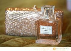 bride's clutch and perfume (Alison Conklin)