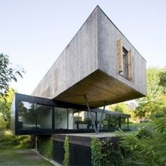 Beautiful house in Sevres, France by Colboc Frances Associes. A series of stacked boxes with glass walls create semi covered outdoor spaces connected with the interiors.
