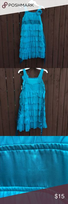 Teal ruffled dress A beautiful teal ruffled dress. Bought from Macy's. Only worn twice and still in nice condition. Has a detachable flower on right shoulder. Hem falls just below the knee. Only defect is in the third picture. Perfect for weddings, recitals, graduations and party's. Macy's Dresses Formal