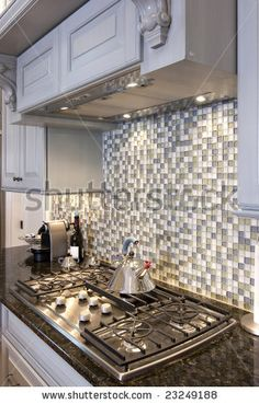 Google Image Result for http://image.shutterstock.com/display_pic_with_logo/9438/9438,1231874692,1/stock-photo-beautiful-kitchen-stove-and-backsplash-made-from-glass-tile-23249188.jpg