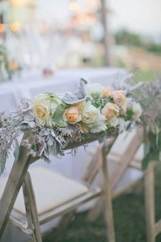 Chair swag with peach garden roses and dusty miller