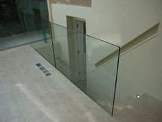 Frameless glass balustrade.  If we can afford the Tormentil staircase from Unique Stairs, this is what it will look like looking out of the living area towards the stairwell.