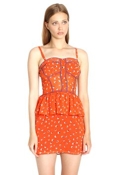 A fun and feminine orange printed dress with a peplum hem and purple piping around the bust that adds a nice touch of color.  100% Polyester  Hand Wash Only