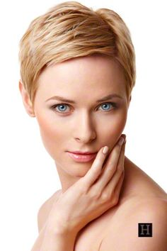 womens short layered pixie hairstyle blonde hair.