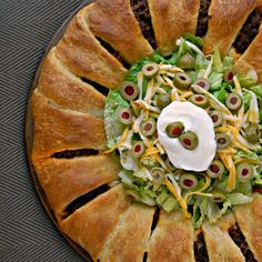 Crescent Taco Ring Recipe Main Dishes with ground beef, taco seasoning, cheddar cheese, water, crescent rolls, olives, lettuce, sour cream, cheddar cheese