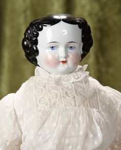 "18"" German porcelain lady with fine original commercial body and lovely costume~~~Porcelain shoulder head, black sculpted curls with center part, painted blue eyes, closed mouth, painted facial features, original early muslin stitch-jointed body, sewn-on red leather boots with tassel ties, brown leather arms, antique costume. Germany, circa 1880"