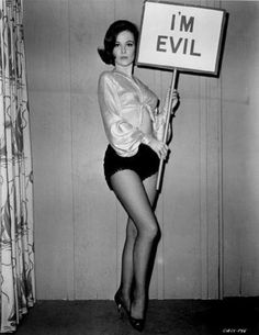 """Just discovered this image is From the Movie """"Girl Happy"""" with Elvis P singing 'Yes she's evil' the actress is Shelley Fabares waving this banner in the scene!14"""