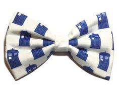 Dr. Who TARDIS themed  fabric bow hair bow on a double prong alligator clip (approx 3 inches in length)  *This is a transformative piece of fiber art made with upcycled material. I am in no way affiliated with the original copyright holders, and this is not an officially licensed item.*