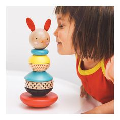 From nursery shelf to the playroom floor, this modern bunny stacker delivers design and delight. Build the bunny by stacking the polished wooden rings onto the post in any order. The smooth rounded based adds a gentle movement during play. Features wool felt ears. Made from sustainably harvested wood. Includes water-based screenprinted accents and non-toxic water-based varnish. Conforms to CPSIA, ASTM, EU, and CE standards. Ages 6 months and up Measures 3.75 x 8.5 in.