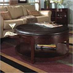 The little pull-out tables for your glass!  Love this coffee table.
