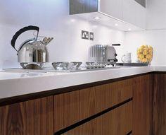 Handless Walnut veneer kitchen designed by Candi Kitchens