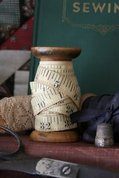 Use an old spool to store your tapemeasure ~ Mamie Janes: Where Bloggers Create