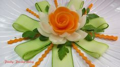Carrot Rose Sitting On Onion lotus Flower With Great Cucumber Designs *It could garnish a platter of rice!