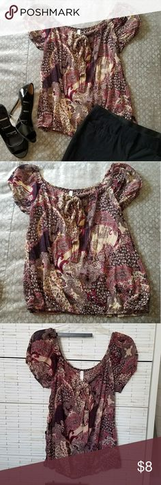 """Chiffon purple paisley scoop neck work blouse This is a cute sheer top to add to your professional wardrobe. Wear a cami under and pair with slacks and dress heels, or even wear with jeans and some wedges. The bottom hem has elastic so it naturally drapes nicely and """"blouses out"""" at the bottom. The neckline also features a bow that drapes down. I love the pattern and colors! Xhilaration Tops Blouses"""