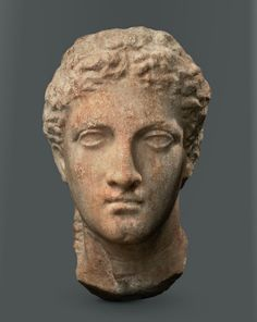 A female head from a marble relief, Greek, 4th century B.C.