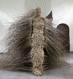 """Illusion: This is a visually interesting sculpture entitled """"Stillness in Motion,"""" which was made from reclaimed willow branches and wire by Olga Ziemska.    (Image © Ziemska)    http://illusion.scene360.com/art/30648/mother-nature/"""