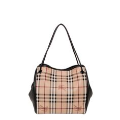 The Burberry style signature is stamped on a chic tote featuring a classic checked pattern. Crafted of PVC and leather and lined with canvas, this go-anywhere bag adds an iconic British fashion accent to your wardrobe.