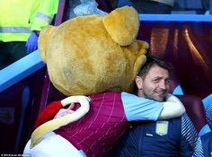 Former Tottenham manager Sherwood is given a good luck hug by the Aston Villa mascot ahead...