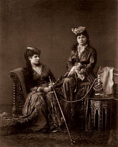 Untitled photo in a harem setting by Abdullah Frères. The Ottoman Armenian brothers Vhichen (1820–1902), Hovsep (1830–1908) and Kevork Abdullah (1839–1918) operated a studio in Istanbul from 1858 to 1900, and sold the firm to Sébah and Joaillier. Known by their French name Abdullah frères (Abdullah brothers), they became official royal photographers to the Ottoman Sultan in 1863, and had the right to use the royal monogram. Between 1866 and 1895, they also had a branch studio in Cairo.