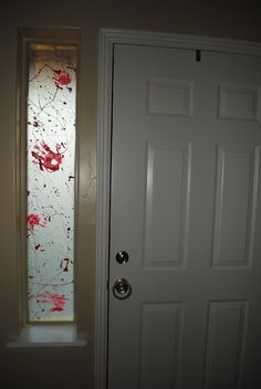 I used wax paper and then splattered red paint all over it to make it look like blood smears. I also painted my hand and stamped it on there to make a slaughter house look. --This would be cool for our windows in Deho