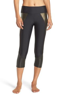 Panels of metallic and faux-leather microfiber put an edgy twist on sporty workout capris.