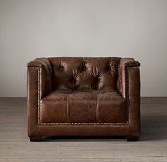 RH's Savoy Leather Chair:Evoking the tailored elegance of English Art Deco furniture of the 1920s, our chair features a square frame and deep button tufting. Sheltering arms envelop, and antique-brass nailheads anchor and define the supple leather.