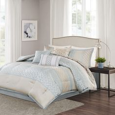 The Bennett Comforter Set provides a peaceful update to your bedroom with its soft shades of seafoam and taupe. Several geometric prints adorn this collection working together in large and small stripes for an updated traditional look. Three decorative pillows use embroidery and fabric manipulation techniques for a cohesive look in your space.