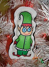 In American folklore, a Christmas elf is a diminutive creature (elf) that lives with Santa Claus in the North Pole and acts as his helper. C...