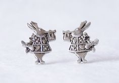 These white rabbit stud earrings are the perfect gift for all Alice in Wonderland lovers! They were handmade with silver-plated charms on