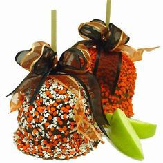 Caramel apples sprinkled with Halloween candies topped with decorative bow...cute for kids parties :))