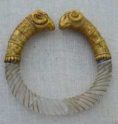 "Ram's head rock-crystal and gold bracelet styled like a torque (ca. Found in Macedonia, near Thessaloniki. From the collection of the Metropolitan Museum. ""The rock-crystal hoops of the bracelets have been carefully cut, carved, and polished Greek Jewelry, Jewelry Art, Jewelry Design, Gold Jewelry, Roman Jewelry, Stone Jewelry, Ancient Jewelry, Antique Jewelry, Vintage Jewelry"