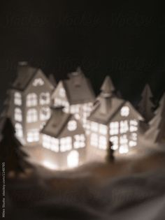 SOFT FOCUS! Blurry image of lighting paper houses in winter