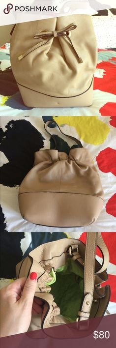 NWOT kate spade Bow Tan Leather Bucket Bag  NWOT kate spade bow tan leather bucket bag. Fits everything without being too big! Fun light green liner and magnetic closure. One large inside pocket and two cell phone size pockets. Bow has silver details. Feet on the bag so the bottom won't get dirty. Classic style that won't go out of style! Comes with kate spade dust bag. kate spade Bags