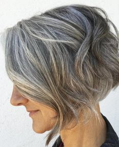 Modern sculptured bob frames the face with softness while shorter layers add texture and height. This is a great choice for thick and naturally wavy hair textures. Photo credit- therighthairstyles.com