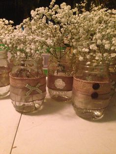 Vintage rustic baby shower/ wedding mason jars--minus the baby's breath, perhaps with wildflowers (in Feb?)