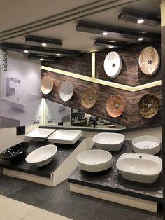Sanitaryware#mirror#contemporary#modern#ideas#washbasins#sloping#display#showroom