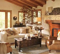 Cream sofa and leather chairs. Wooden coffee table. I like all this stuff
