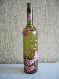Pin by Emily Youngberg on wine bottle painting ideas Wine Bottle Vases, Empty Wine Bottles, Recycled Wine Bottles, Glass Bottle Crafts, Lighted Wine Bottles, Diy Bottle, Bottle Lights, Wine Glass, Painted Glass Bottles