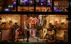 Liberty (2015) - the Regent Street store has transformed its windows into a series of rooms resembling a giant dolls house...
